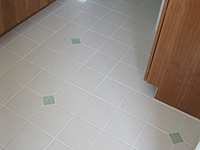 Ceramic Tiled Bathroom Floor w/ a Simple Pattern