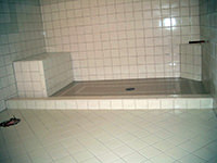 Ceramic Tiled Shower with a Seat and Foot Stool